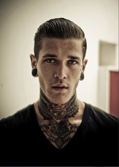 Stretched ears, neck tattoo, and classic hair