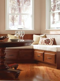 Enhance your space with bench seating, featuring the Braddock Alder Clove door style by Thomasville Cabinetry.