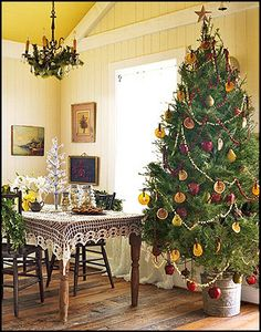 Country Christmas tree...love the dried oranges & pears for ornaments