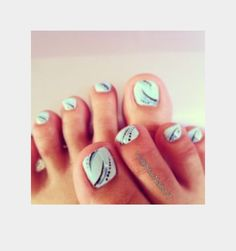Baby blue with black and white design on all toes