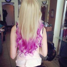 Brown Hair with Purple Tips | Blonde hair with a light purple ombre dipped dye and curls.