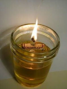 Mason jar, oil, 1/2 a cork (make a hole through it), wick, fire. Put the lid on, for storing it.