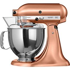 KITCHEN AID Artisan mixer - Fancy getting creative in the kitchen? KitchenAid's Artisan stand mixer, now in a beautiful satin copper finish, has a large capacity to make mixing in batches a breeze, as well as a tilt up head design to ensure easy cleaning and usage. The combination of high quality craftsmanship and good looks will make food prep a pleasure.