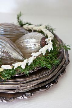 Old silver, greens and mercury glass ornaments. So simple and beautiful.