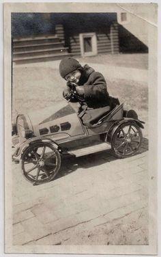 1920's Little boy in pedal car.