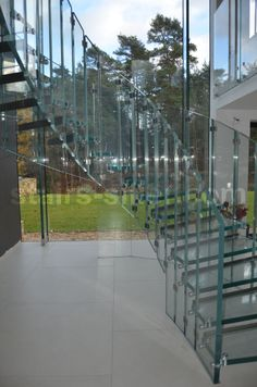 Elyptical staircase in all glass, project in UK http://www.stairs-siller.com/references/surrey-england/