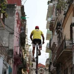 Felix Guirola, 52, rides a homemade bike with an advertising banner in Havana, Cuba, July 20, 2016. Cubans are adept at inventing ways to earn cash but Felix Guirola stands - or rather, cycles - head and shoulders above them. The handyman, who loves heights, provides advertising space for companies on homemade bikes that tower up to 7.5 meters (24.61 ft). He rides them around Havana in an ingenious way of getting around strict marketing regulations in the Communist-ruled island…