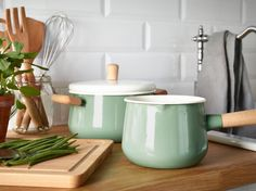 I've been seeing a lot of pretty enamel cookware in chic boutique shops, online and off, but it usually comes at a high price (like my favorite splurgy Japanese pan). IKEA hits the look and practicality of enameled cookware at a great price point. I love the retro green color and cool wood handles on this saucepan and the accompanying pot — some of my favorite new things lately from IKEA.