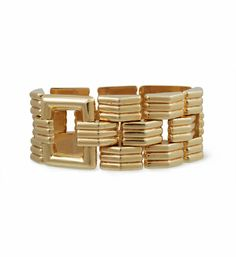 A Retro gold tank bracelet of ribbed links with two square gold spacers, in 14k from Cartier