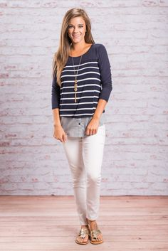 This striped top is just your type! It's adorable, it's soft and it has a preppy, layered look that we know you love!! The jersey knit fabric is so soft and is a fab contrast with the faux button up layer at the hemline. Because of this tops coloring we think it looks best with white skinnies!