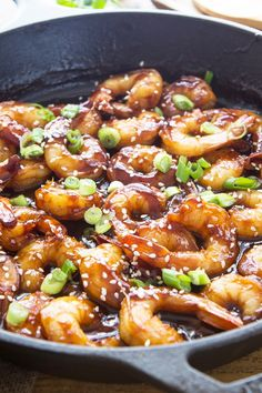 4 Ingredient Hoisin Skillet Shrimp Recipe - shrimp cooked in hoisin sauce, then garnished with garnished with sesame seeds and green onion.
