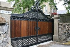 GatesIron announced the availability of their new Solid wooden driveway gates with wrought iron frames. Gate showrooms in Manchester, Lancashire and Birmingham showing working examples of electric wooden gates and wrought iron gates. Front Gate Design, House Gate Design, Door Gate Design, Small House Design, Fence Design, Main Gate Design, Wrought Iron Driveway Gates, Front Gates, Entrance Gates