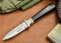 Alan Warren: Custom Boot Knife - Blackwood - Bronze and Fossil Walrus Spacer