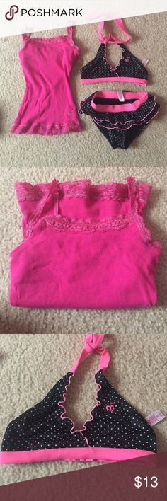 Justice Girls Size 7 bathing suit and camisole Cute black/pink/white polka dot bikini with ruffles! Good used condition (does have some fuzz on bottom from concrete at pool). Pink lace camisole (6/7) also comes with suit. Justice Swim Bikinis
