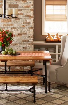 Style meets utility in this harvest table and benches featuring beautiful stained boards and and a pipe frame.
