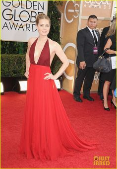 Amy Adams is wearing a Valentino dress, Brian Atwood shoes, a Valentino clutch, and Lorraine Schwartz jewelry.