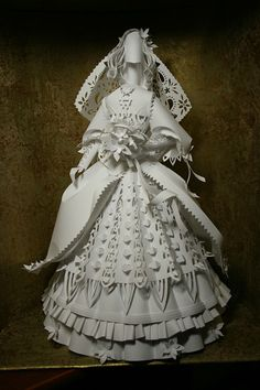Paper Bride. This paper wedding dress, rather close to modern Ukrainian or Russian. Working time about 2 days. This doll was made for the wedding exhibition as part of of wedding decor.