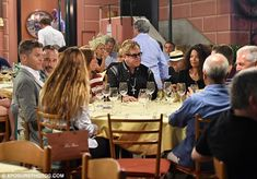 Pleasant conversation: The couples sat apart, presumably to encourage…