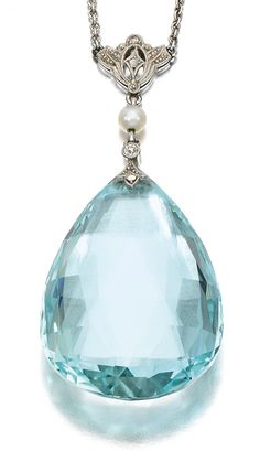 AQUAMARINE AND DIAMOND PENDANT, 1910S. Suspending a pear-shaped facetted aquamarine drop to a circular-cut, rose diamond and pearl surmount on a curb link chain, length approximately 455mm.
