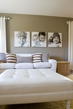 how to decorate the wall above the coach with family photos | This gray wall in the living room is a sophisticated backdrop for ...