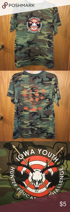 """Iowa YHEC camouflage tshirt Camo short sleeve tshirt with graphic design from the Iowa Youth Hunter Education Challenge. The back has sponsor names and logos printed in orange. In good used condition with piling. Material: 60% cotton, 40% polyester. Measures about 19"""" across the front between armpits when flat. rothco Shirts Tees - Short Sleeve"""