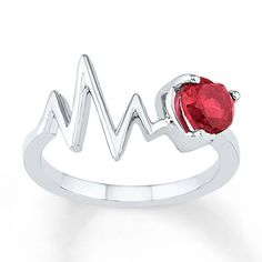 Representing a heartbeat, this delightful ring for her features a zig-zag line and a heart-shaped lab-created ruby. The ring is styled in sterling silver.