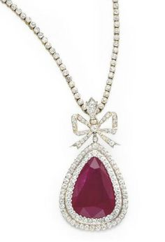 A BELLE EPOQUE RUBY AND DIAMOND PENDANT NECKLACE, BY DREICER. Circa 1905.