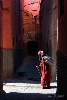 A woman walks in an alley in Marrakech.Morocco