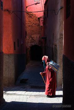 A woman walks in an alley in Marrakech, Morocco. For luxury hotels in Marrakech visit http://www.mediteranique.com/hotels-morocco/marrakech/