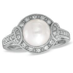 my favorite so far . <3 I've tagged a product on Zales: 7.5 - 8.0mm Cultured Freshwater Pearl and White Topaz Ring in Sterling Silver with Diamond Accents - Size 7