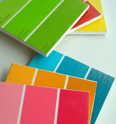 Coasters.  Pantone color chips, paint color chips, any color pallets you like to look at over and over again.  Or just match your decor and forget about it.