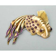 MAUBOUSSIN RUBY BICOLOR GOLD AND PLATINUM FISH BROOCH, ca. 1940.