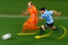 World Cup 2010 - Martin Caceres, Uruguay and Arjen Robben, The Netherlands