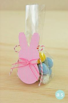 Adorable Easter treats made with Cadbury eggs, pink baker's cording and a peep bunny tag. Easy Easter favors. #amusestudio #diyparty #peep