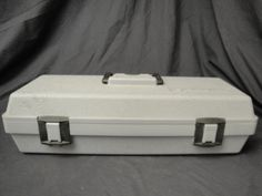 Nice Hard Gray Plastic Dremel Tool Box with black handle and latches. Inside are Dremel accessories. One is a pack unopened.