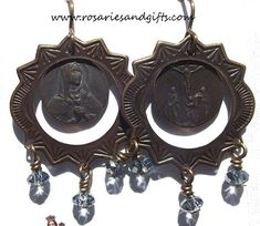 Earrings in honor of Our Lady of Sorrows. The medal has one side with Our Lady of Sorrows and the other side with the crucifixion. If you