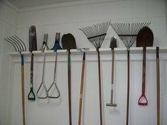 Garden tool organization for the garage| love the shelf to catch dirt or grass