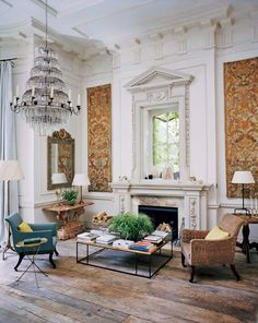 Old and New Uniacke's cultivated eye for antiques is showcased in the family sitting room, where Sicilian tapestries from the 17th century flank the fireplace and an 18th-century Italian marble console table sits nearby. Suspended above is a 19th-century waterfall chandelier attributed to the Spanish Royal Glassworks.