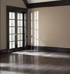 Paining the molding from white to dark brown changes the rooms feel