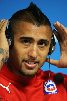 Arturo Vidal listens to a question during the Chile Press Conference at the 2014 FIFA World Cup Brazil held at the Arena de Sao Paulo on Jun...