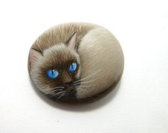 Hand painted rock siamese cat