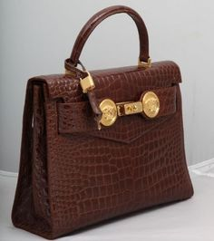 e7eff50b90c7 View this item and discover similar top handle bags for sale at - Very rare Gianni  Versace Couture croc embossed bag with gold medusas.