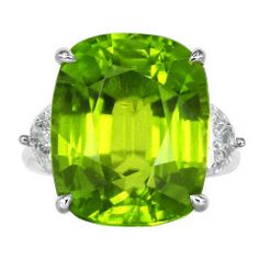 22.14 Carat Peridot Diamond Three Stone Ring