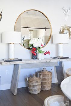 farmhouse style Trends Farmhouse Style how to make a cozy and inviting home with flowers round gold mirror sw on the rocks modern rustic console table marble and brass lamps baskets under console 3 Rustic Furniture, Home Furniture, Selling Furniture, Furniture Online, Furniture Stores, Rustic Console Tables, Rustic Office, Rustic Bench, Rustic Shelves