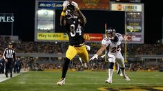 <p>PITTSBURGH, PA - DECEMBER 20: Antonio Brown #84 of the Pittsburgh Steelers catches a touchdown pass in the third quarter of the game against the Denver Broncos at Heinz Field on December 20, 2015 in Pittsburgh, Pennsylvania. (Photo by Gregory Shamus/Getty Images)</p>