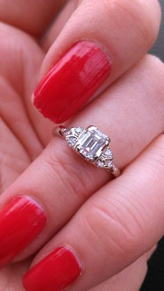 Gorgeous engagement ring !!! Made from 14k gold, center emerald cut diamond VS-SI, G-H, approx. 0.40ct, small diamonds on the side...size 5 3/4,