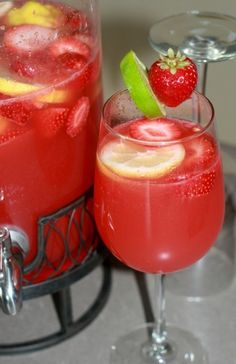 Strawberry Limeade Rum Punch Ingredients:  2 liter ginger ale 12 ounces frozen limeade 10 ounces frozen Bacardi strawberry Daiquiri (freezer section) 2½ cups rum lemon, lime and strawberries (Sliced. I used 1 lemon, 2 limes and most of a carton of strawberries… you could also use frozen berries) Instructions:  Thaw frozen concentrates and then mix all ingredients together in a punch bowl or other beverage dispenser. Add ice and serve.