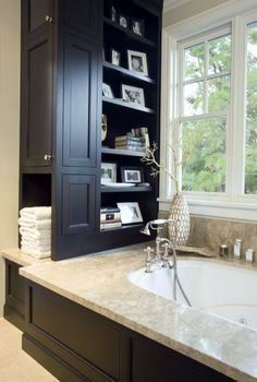 Gorgeous built in soaking tub with the classic feel with tons of great storage incorporated into the side built-in/shelf area that can often become wasted space, especially if you like to center the tub on the window!