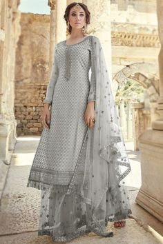 Enhance your ethnic charm by wearing this grey georgette sharara suit which comprises an elegant ethnic look. This u neck and full sleeve costume designed with dori work. Teamed up with net sharara pant in grey color with grey net dupatta. Sharara pant has dori work. Dupatta designed using dori work. #shararasuits #malaysia #Indianwear #weddingwear #andaazfashion Sharara Suit, Salwar Kameez, Indian Attire, Indian Wear, Pantalon Cigarette, Ethnic Looks, Suit Fabric, Sequin Top, Wedding Wear