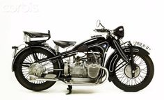 Super art deco.  Love the passenger seat too.  1931 BMW Motorcycle